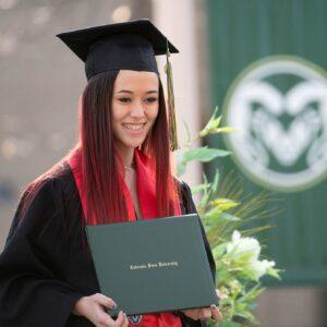 A CSU graduate holds her diploma